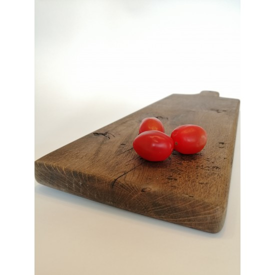 The wooden cutting board is long
